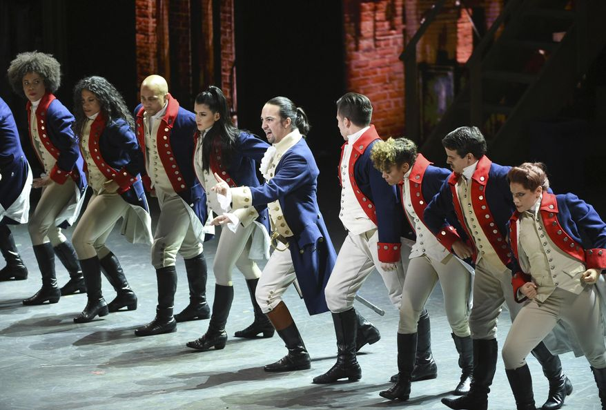 """FILE - In this June 12, 2016 file photo, Lin-Manuel Miranda, center, and the cast of """"Hamilton"""" perform at the Tony Awards in New York. Ever since the historical musical began its march to near-universal infatuation, one group has noticeable withheld its applause, historians. Many academics argue the onstage portrait of Alexander Hamilton is a counterfeit. Now they're escalating their fight. (Photo by Evan Agostini/Invision/AP, File)"""