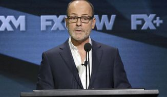 FILE - In this Aug. 3, 2018 file photo, John Landgraf, CEO, FX Networks and FX Productions, participates in the executive panel during the FX Television Critics Association Summer Press Tour in Beverly Hills, Calif.  Landgraf said Monday, Feb. 4, 2019, that Netflix is using cloudy measurements to claim increasing dominance among viewers. (Photo by Willy Sanjuan/Invision/AP, File)