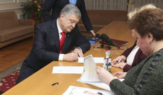 Ukraine's President Petro Poroshenko is registered as a candidate for the presidency at the Central Election Commission Sunday, Feb. 3, 2019. Presidential vote in Ukraine is to take place on March 31. (Mikhail Palinchak, Presidential Press Service via AP)