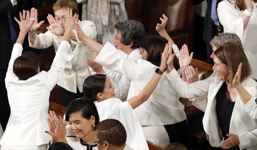 Women members of Congress, including Rep. Alexandria Ocasio-Cortez, D-N.Y., center, cheer after President Donald Trump acknowledges more women in Congress during his State of the Union address to a joint session of Congress on Capitol Hill in Washington, Tuesday, Feb. 5, 2019. (AP Photo/J. Scott Applewhite) **FILE**