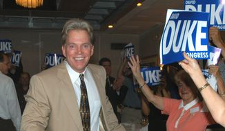 Former Ku Klux Klan leader David Duke enters a room of supporters during a reception in Kenner, La., Saturday, May 29, 2004.  Fresh out of prison for bilking supporters, Duke hosted a weekend gathering of enthusiastic backers eager to hear him as he lashed out at Jews, blacks, immigrants and the ``Zionist-controlled media.'' (AP Photo/Burt Steel)