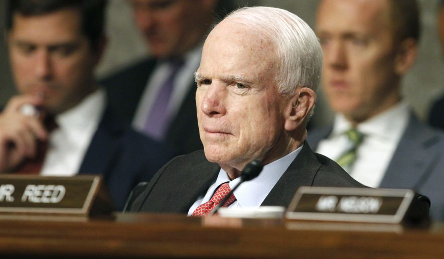 In this July 11, 2017, file photo, Senate Armed Services Committee Chairman Sen. John McCain, R-Ariz. listens on Capitol Hill in Washington, during the committee's confirmation hearing for Nay Secretary nominee Richard Spencer. (AP Photo/Jacquelyn Martin, File)