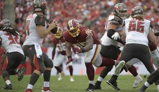Tampa Bay Buccaneers quarterback Ryan Fitzpatrick (14) is pressured by Washington Redskins nose tackle Daron Payne (95) during the second half of an NFL football game Sunday, Nov. 11, 2018, in Tampa, Fla. (AP Photo/Phelan M. Ebenhack) ** FILE **