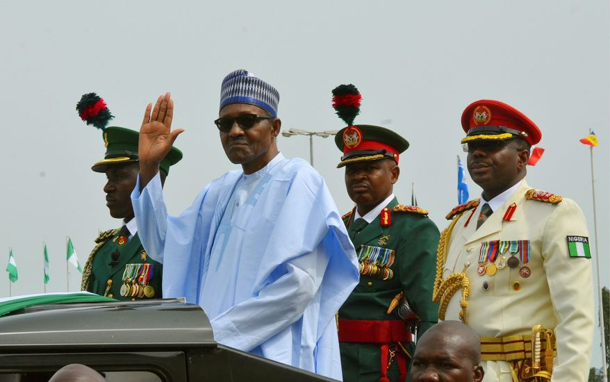 "In this Monday, Oct. 1, 2018, file photo, Nigerian President Muhammadu Buhari waves to the crowd during the 58th anniversary celebrations of Nigerian independence, in Abuja, Nigeria. The United States and European Union are expressing concern after Nigeria's president suspended the country's chief justice on Friday, Jan. 25, 2019, three weeks before the presidential election, with the U.S. warning it could ""cast a pall"" over the vote. (AP Photo/Olamikan Gbemiga, File)"