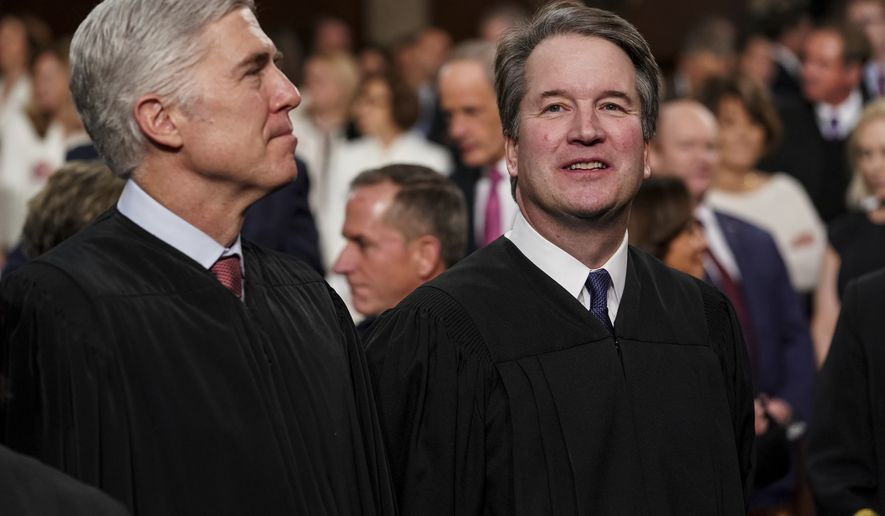 Supreme Court Associate Justices Neil Gorsuch, left, and Brett Kavanaugh watch as President Donald Trump arrives to give his State of the Union address to a joint session on Congress at the Capitol, Tuesday, Feb. 5, 2019 in Washington. (Doug Mills/The New York Times via AP, Pool)