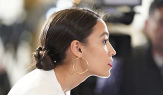 Rep. Alexandria Ocasio-Cortez, D-N.Y., arrives to hear President Donald Trump deliver his State of the Union address to a joint session of Congress on Capitol Hill in Washington, Tuesday, Feb. 5, 2019. (AP Photo/Carolyn Kaster)