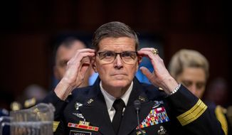 "U.S. Central Command Commander Gen. Joseph Votel testifies before a Senate Armed Services Committee hearing on Capitol Hill, Tuesday, Feb. 5, 2019, in Washington.  Votel told the committee that of the 34,000 square miles of territory that IS once held, it now controls less than 20 square miles. ""It is important to understand that even though this territory has been reclaimed, the fight against ISIS and violent extremists is not over and our mission has not changed.""  (AP Photo/Andrew Harnik)"