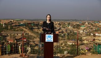 Hollywood actress Angelina Jolie addresses a press conference at Kutupalong refugee camp in Cox's Bazar, Bangladesh, Tuesday, Feb. 5, 2019. Nearly 700,000 Rohingya, a persecuted Muslim minority in Myanmar, are living in refugee camps in coastal Cox's Bazar after fleeing their villages following a military crackdown. (AP Photo)