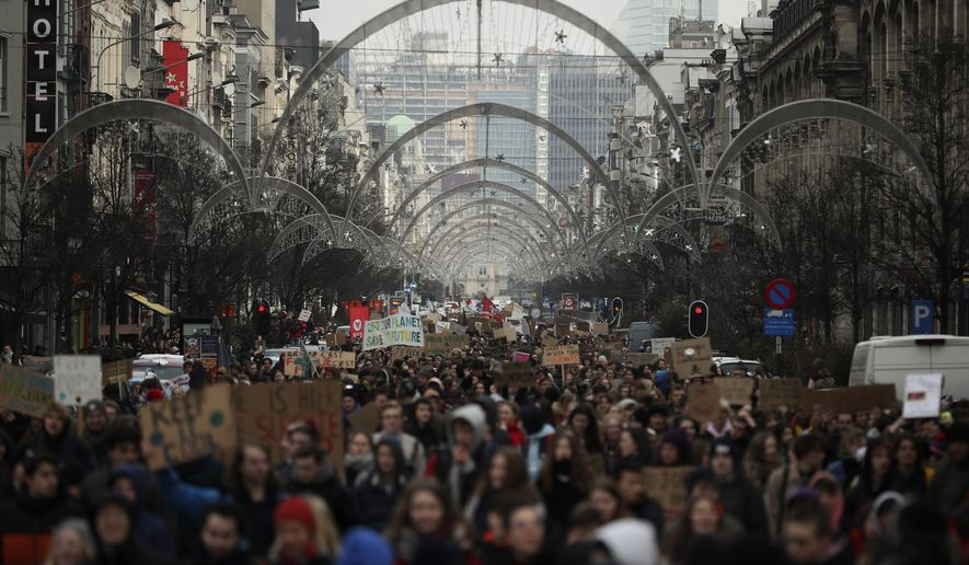 Thousands of youngsters march during a climate change protest in Brussels, Thursday, Jan. 31, 2019. Thousands of teenagers in Belgium have skipped school for the fourth week in a row in an attempt to push authorities into providing better protection for the world's climate. (AP Photo/Francisco Seco)