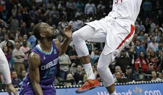 Los Angeles Clippers' Tobias Harris (34) shoots the go-ahead and eventual game-winning basket against Charlotte Hornets' Kemba Walker (15) during the second half of an NBA basketball game in Charlotte, N.C., Tuesday, Feb. 5, 2019. (AP Photo/Chuck Burton)