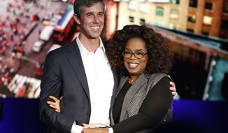 "Former Democratic Texas congressman Beto O'Rourke, left, stands with Oprah Winfrey after appearing on ""Oprah's SuperSoul Conversations from Times Square"" Tuesday, Feb. 5, 2019, in New York. The lineup on Tuesday also features actors Bradley Cooper and Michael B. Jordan and philanthropist Melinda Gates, underscoring the sense of celebrity that surrounds O'Rourke. (AP Photo/Kathy Willens)"
