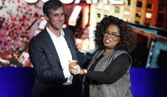 "Former Democratic Texas congressman Beto O'Rourke, left, appears with Oprah Winfrey for ""Oprah's SuperSoul Conversations from Times Square"" Tuesday, Feb. 5, 2019, in New York. The lineup on Tuesday also features actors Bradley Cooper and Michael B. Jordan and philanthropist Melinda Gates, underscoring the sense of celebrity that surrounds O'Rourke. (AP Photo/Kathy Willens)"