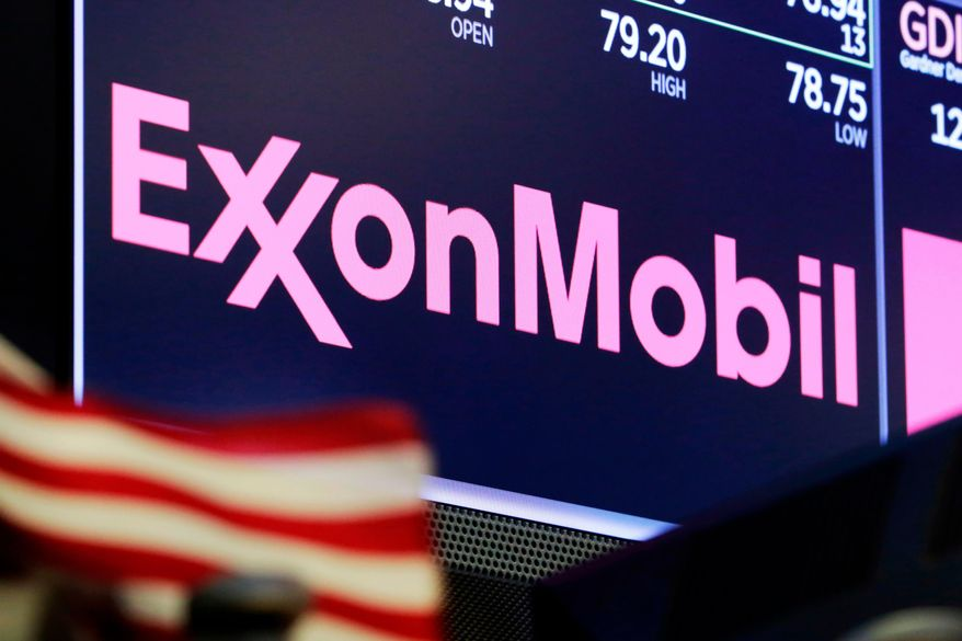 FILE - In this April 23, 2018, file photo, the logo for ExxonMobil appears above a trading post on the floor of the New York Stock Exchange. Exxon Mobil is making a big bet on the future of exporting natural gas. Exxon and Qatar Petroleum announced Tuesday, Feb. 5, 2019, that they will go ahead with a $10 billion project to expand a liquefied natural gas export plant on the Texas Gulf Coast. (AP Photo/Richard Drew, File)
