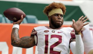 FILE - In this Saturday, Oct. 6, 2018, file photo, Florida State quarterback Deondre Francois (12) warms up before an NCAA college football game against Miami, in Miami Gardens, Fla. Florida State head football coach Willie Taggart announced Sunday, Feb. 3, 2019, that Francois has been dismissed from the team after allegations of domestic abuse surfaced. (AP Photo/Lynne Sladky, File)