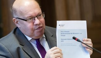 "German Economy Minister Peter Altmaier presents the ""National Industry Strategy 2030,"" measures to secure the economic and technological leadership of Germany and the European Union in Berlin, Germany, Tuesday, Feb.5, 2019. (Bernd von Jutrczenka/dpa via AP)"