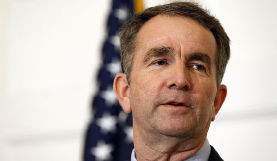 In this Feb. 2, 2019, file photo, Virginia Gov. Ralph Northam speaks during a news conference in the Governor's Mansion in Richmond, Va.  Northam clung to his office Tuesday, Feb. 5, amid intense political fallout over a racist photo in his 1984 medical school yearbook and uncertainty about the future of the state's government. (AP Photo/Steve Helber, File)