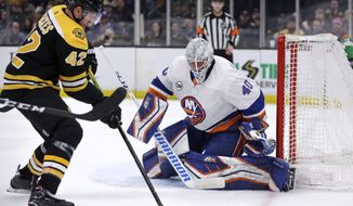 New York Islanders goaltender Robin Lehner (40) eyes the puck as Boston Bruins right wing David Backes (42) prepares to shoot during second period of an NHL hockey game in Boston, Tuesday, Feb. 5, 2019. (AP Photo/Charles Krupa)