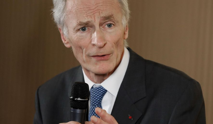 FILE - In this Jan. 24, 2019, file photo, Jean-Dominique Senard addresses the media after being appointed Renault chairman following a meeting of the board at Renault headquarters in Boulogne-Billancourt, outside Paris, France. Nissan Motor Co.'s board chose Tuesday, Feb. 5, 2019, as a director Senard, who was recently appointed chairman at the Japanese automaker's alliance partner Renault SA. (AP Photo/Christophe Ena, File)