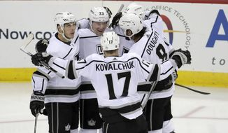 Los Angeles Kings right wing Tyler Toffoli, second from left, celebrates his first third-period goal with teammates during an NHL hockey game against the New Jersey Devils, Tuesday, Feb. 5, 2019, in Newark, N.J. The Kings won 5-1. (AP Photo/Julio Cortez)