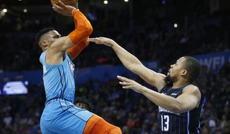 Oklahoma City Thunder guard Russell Westbrook, left, shoots over Orlando Magic guard Isaiah Briscoe (13) during the first half of an NBA basketball game in Oklahoma City, Tuesday, Feb. 5, 2019. (AP Photo/Sue Ogrocki)