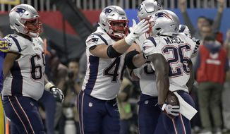 New England Patriots' Sony Michel (26) celebrates his touchdown with James Develin, center, during the second half of the NFL Super Bowl 53 football game against the Los Angeles Rams, Sunday, Feb. 3, 2019, in Atlanta. (AP Photo/David J. Phillip)