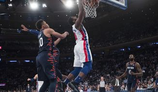 Detroit Pistons center Andre Drummond dunks during the first half of an NBA basketball game against the New York Knicks, Tuesday, Feb. 5, 2019, at Madison Square Garden in New York. (AP Photo/Mary Altaffer)
