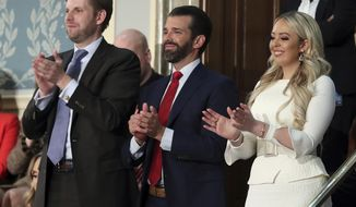 Eric Tump, left, Donald Trump Jr., center and Tiffany trump applaud as President Donald Trump delivers his State of the Union address to a joint session of Congress on Capitol Hill in Washington, Tuesday, Feb. 5, 2019. (AP Photo/Andrew Harnik) ** FILE **