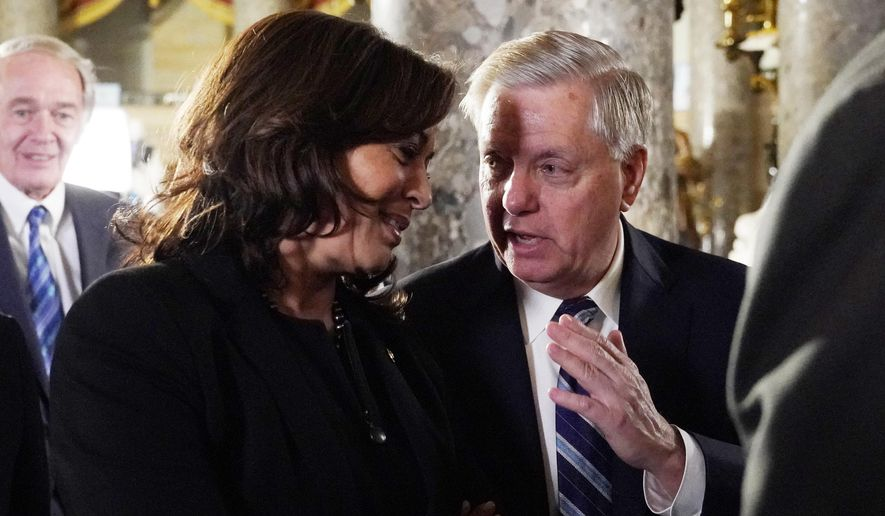 Sen. Kamala Harris, D-Calif and Sen. Lindsey Graham, R-S.C. talk as they arrive to listen to President Donald Trump deliver his State of the Union address to a joint session of Congress on Capitol Hill in Washington, Tuesday, Feb. 5, 2019. (AP Photo/Carolyn Kaster)
