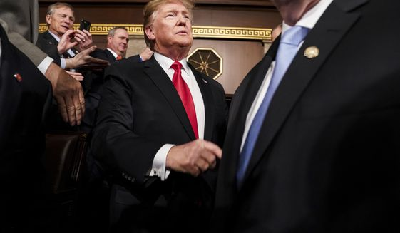 President Donald Trump arrives in the House chamber before giving his State of the Union address to a joint session of Congress, Tuesday, Feb. 5, 2019 at the Capitol in Washington. (Doug Mills/The New York Times via AP, Pool)