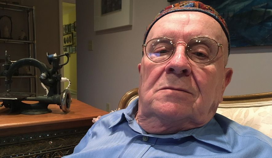 Holocaust survivor Judah Samet, 80, sits in his living room in Pittsburgh. Samet who escaped the Oct. 27, 2018 Pittsburgh synagogue shooting and a police officer who was wounded responding to the massacre will be among the guests sitting with first lady Melania Trump at the State of the Union address on Tuesday, Feb. 5, 2019.  (AP Photo/Allen G. Breed, File)