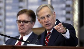 Texas Lt. Gov. Dan Patrick, left, listens as Texas Gov. Greg Abbott, right, gives his State of the State Address in the House Chamber, Tuesday, Feb. 5, 2019, in Austin, Texas. (AP Photo/Eric Gay)