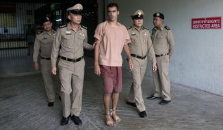 Bahraini Hakeem al-Araibi, center, leaves the criminal court in Bangkok, Thailand, Bangkok, Thailand, Monday, Feb. 4, 2019. The soccer player who has refugee status in Australia told a Thai court Monday that he refuses to be voluntarily extradited to Bahrain, which has asked for his return to serve a prison sentence for a crime he denies committing.(AP Photo/Sakchai Lalit)