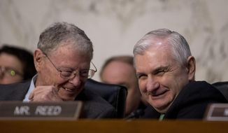 Chairman Sen. Jim Inhofe, R-Okla., left, and Ranking Member Sen. Jack Reed, D-R.I., right, speak together as U.S. Central Command Commander Gen. Joseph Votel testifies at a Senate Armed Services Committee hearing on Capitol Hill, Tuesday, Feb. 5, 2019, in Washington. (AP Photo/Andrew Harnik) ** FILE **