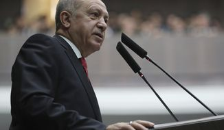 Turkey's President Recep Tayyip Erdogan addresses the MPs of his ruling Justice and Development Party at the parliament, in Ankara, Turkey, Tuesday, Feb. 5, 2019. (Presidential Press Service via AP, Pool)