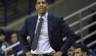 FILE - In this Feb. 7, 2018, file photo, Connecticut head coach Kevin Ollie watches from the sideline during the first half an NCAA college basketball game in Storrs, Conn. A federal judge dismissed a complaint on Tuesday, Feb. 5, 2019, filed by Ollie connected to his allegations that his firing was in part racially motivated, deciding the complaint was filed prematurely. The judge did not rule on the merits of the request. (AP Photo/Jessica Hill, File)