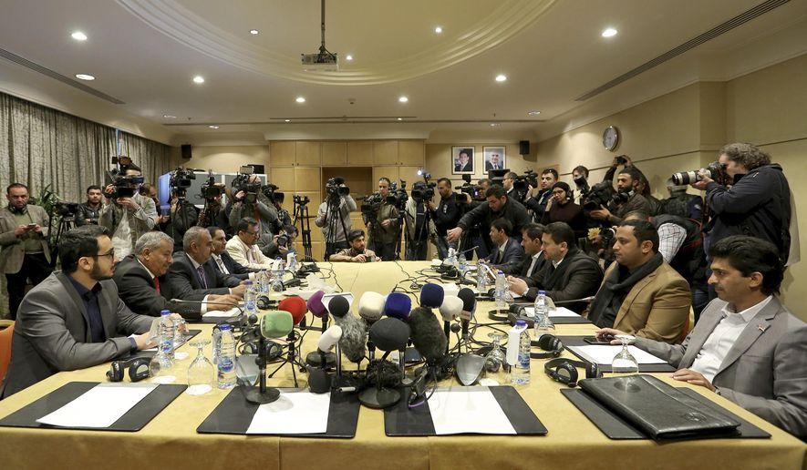 The Houthi rebel delegation, right, and delegates of the internationally recognized Yemeni government hold talks on Yemen, in Amman, Jordan, Tuesday, Feb. 5, 2019. (AP Photo/Raad Adayleh)