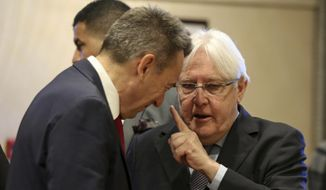 """United Nations Special Envoy to Yemen Martin Griffith, right, speaks to President of the International Committee of the Red Cross (ICRC), Peter Maurer, during talks on Yemen, in Amman, Jordan, Tuesday, Feb. 5, 2019. Yemen's government and the Houthi rebels are meeting in Jordan for talks on implementing a stalled prisoner exchange agreed upon in December. Griffiths said Tuesday that the three-day meeting aims to """"finalize the list of prisoners and detainees to be released and exchanged."""" (AP Photo/Raad Adayleh)"""