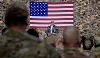 President Trump has cited the large American contingent deployed at the Al-Asad air base in western Iraq, where he visited the day after Christmas, as one key reason the U.S. can afford to pull out 2,000 troops battling the Islamic State in Syria. (ASSOCIATED PRESS)