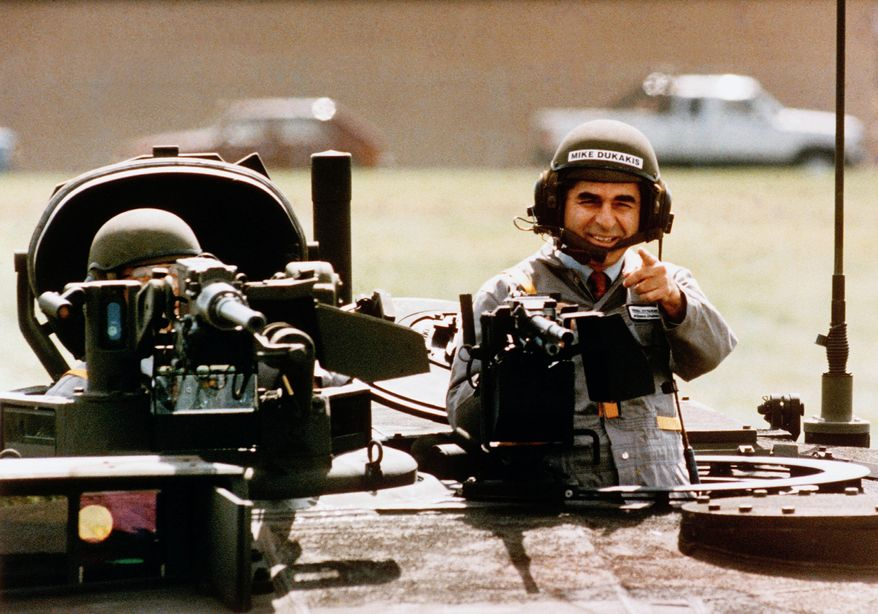 Democratic presidential candidate Michael Dukakis gets a free ride in one of General Dynamics' new M1-A-1 battle tanks at its land systems division in Sterling Heights, Michigan, on Tuesday, Sept. 13, 1988. Dukakis took time out to tell General Dynamics workers that he's not soft on defense. (AP Photo/Michael E. Samojeden)