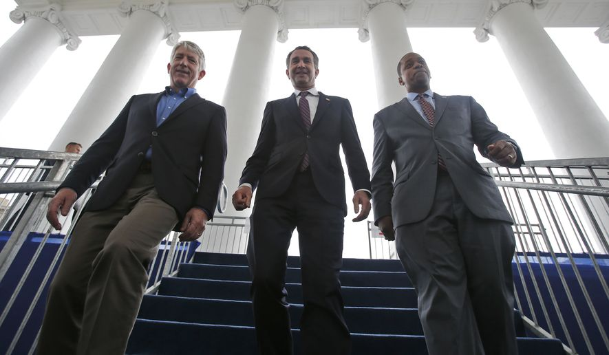 In this Jan. 12, 2018, file photo, Virginia Gov.-elect, Lt. Gov Ralph Northam, center, walks down the reviewing stand with Lt. Gov-elect, Justin Fairfax, right, and Attorney General Mark Herring at the Capitol in Richmond, Va. (AP Photo/Steve Helber, File)