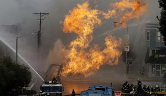 San Francisco firefighters battle a fire on Geary Boulevard in San Francisco, Wednesday, Feb. 6, 2019. A gas explosion in a San Francisco neighborhood shot flames high into the air Wednesday and was burning several buildings as utility crews scrambled to shut off the flow of gas. Construction workers cut a natural gas line, San Francisco Fire Chief Joanne Hayes-White said. (AP Photo/Jeff Chiu)