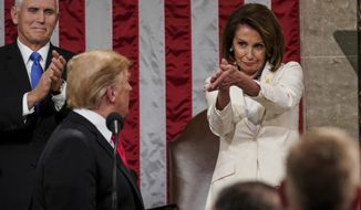 President Donald Trump turns to House Speaker Nancy Pelosi of California, as he delivers his State of the Union address to a joint session of Congress on Capitol Hill in Washington, as Vice President Mike Pence watches, Tuesday, Feb. 5, 2019. (Doug Mills/The New York Times via AP, Pool) ** FILE **