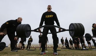 U.S Army 1st Lt. Mitchel Hess participates in a weight lifting drill while preparing to be an instructor in the new Army combat fitness test at Fort Bragg, North Carolina, Jan. 8, 2019. The new test is designed to be a more accurate test of combat readiness than the current requirements. (AP Photo/Gerry Broome)  ** FILE **