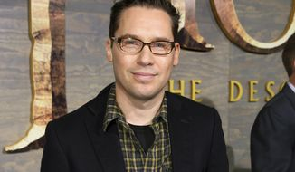 "FILE - This Dec. 2, 2013 file photo shows Bryan Singer at the Los Angeles premiere of ""The Hobbit: The Desolation of Smaug.""  The British Academy of Film and Television Arts says that it is suspending its nomination of director Bryan Singer amid accusations that he sexually assaulted minors. (Photo by Matt Sayles/Invision/AP, File)"