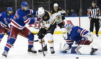 New York Rangers goaltender Alexandar Georgiev (40) and defenseman Kevin Shattenkirk (22) tends the net against Boston Bruins left wing Jake DeBrusk (74) in the first period of an NHL hockey game, Wednesday, Feb. 6, 2019, at Madison Square Garden in New York. (AP Photo/Mary Altaffer)