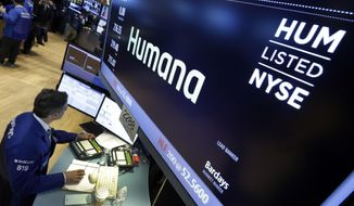 FILE- In this June 8, 2015, file photo specialist Anthony Rinaldi works adjacent to the post that handles Humana, on the floor of the New York Stock Exchange. Humana Inc. reports financial results Wednesday, Feb. 6, 2019. (AP Photo/Richard Drew, File)