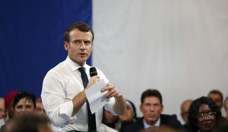 "FILE - In this Feb.4, 2019 file photo, French President Emmanuel Macron speaks during a meeting with mayors and local association members as part of the ""national debate"", in Evry-Courcouronnes, south of Paris. Macron is clawing back support as the French leader tries to quell yellow vest protest anger by putting himself at the forefront of a national political debate. (AP Photo/Thibault Camus)"