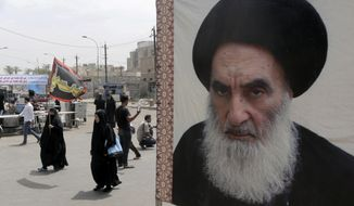 FILE - In this May 22, 2014 file photo, shiite pilgrims pass a poster of Shiite spiritual leader Grand Ayatollah Ali al-Sistani, as they head to the shrine of Imam Moussa al-Kadhim in Baghdad, Iraq. On Wednesday, Feb. 6, 2019, Al-Sistani, Iraq's most senior Shiite cleric, expressed his criticism of President Donald Trump's recent statement that U.S. troops should stay in Iraq to keep an eye on neighboring Iran. He is the latest Iraqi official to criticize Trump's remarks. (AP Photo/Khalid Mohammed, File)