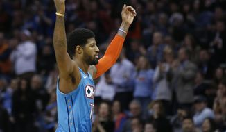 Oklahoma City Thunder forward Paul George gestures to the crowd after a basket during the second half of the team's NBA basketball game against the Orlando Magic in Oklahoma City, Tuesday, Feb. 5, 2019. (AP Photo/Sue Ogrocki) ** FILE **