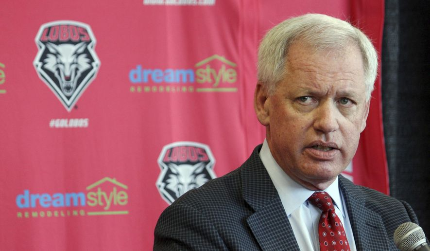 FILE - In this May 3, 2017, file photo, then-University of New Mexico athletics director Paul Krebs answers questions during a news conference in Albuquerque, N.M. Krebs has been charged with fraud and money laundering. The New Mexico Attorney General's Office filed a criminal complaint Wednesday, Feb. 6, 2019, against Krebs in connection with a 2015 golf trip to Scotland and allegations he tried to conceal a $25,000 donation. (AP Photo/Susan Montoya Bryan, File)